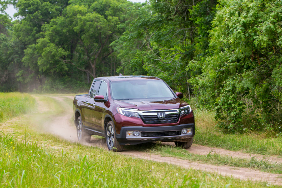 A photo of the 2019 Honda Ridgeline driving on a dirt road.