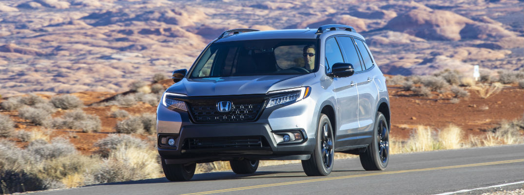 A photo of the 2019 Honda Passport on the road in the desert.