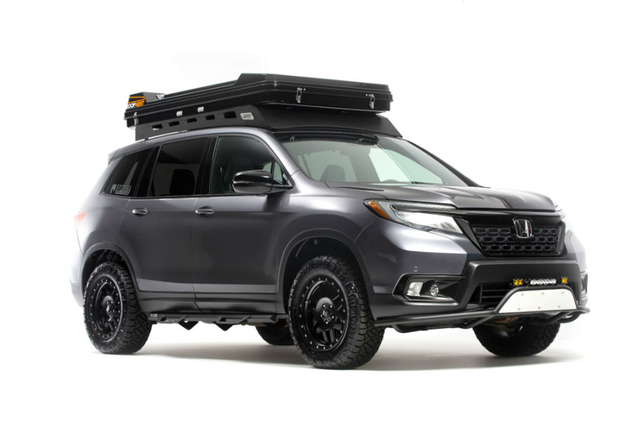 A front right quarter photo of the Honda Passport with extra off-road accessories added to it.