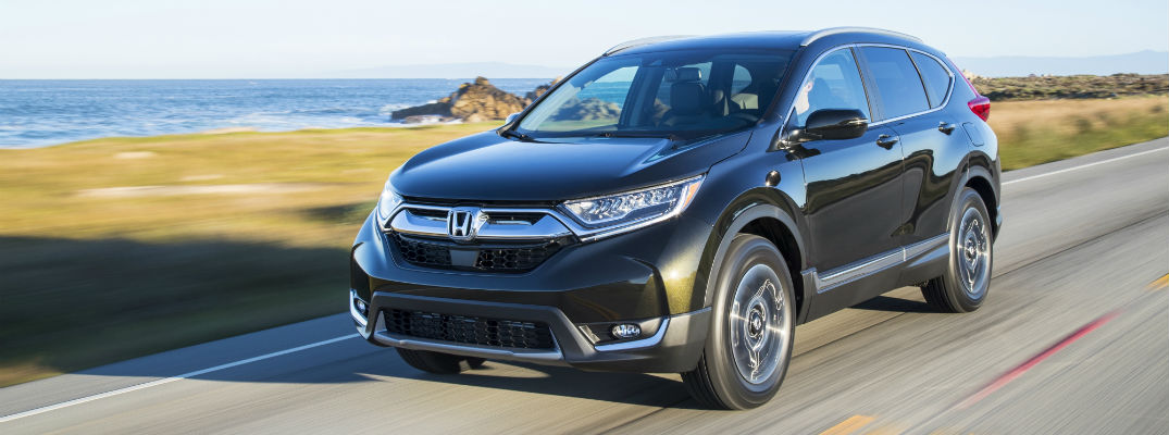 A front left quarter photo of the 2019 Honda CR-V on the road.