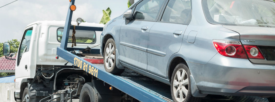 A stock photo of a vehicle being towed away after a breakdown.