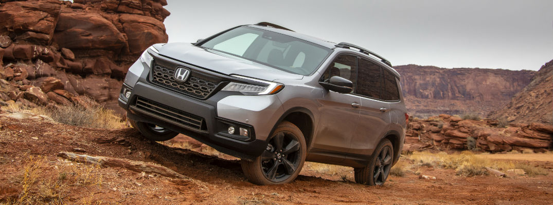 A photo of the 2019 Honda Passport parked on an incline in the desert.
