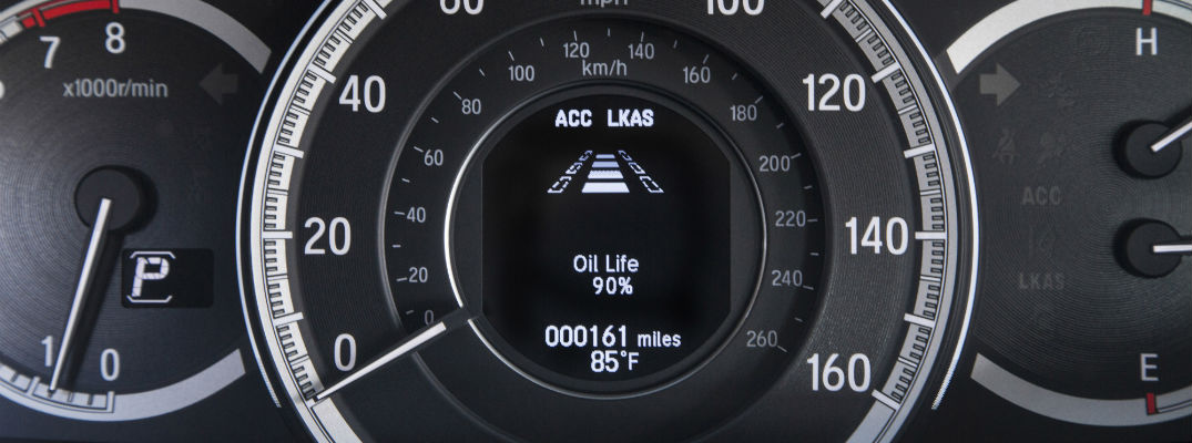 A photo of a center gauge cluster on a vehicle with Honda Sensing®.
