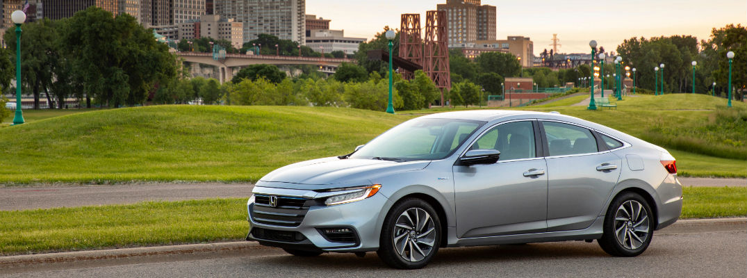 A left profile photo of the 2020 Honda Insight parked on the road.