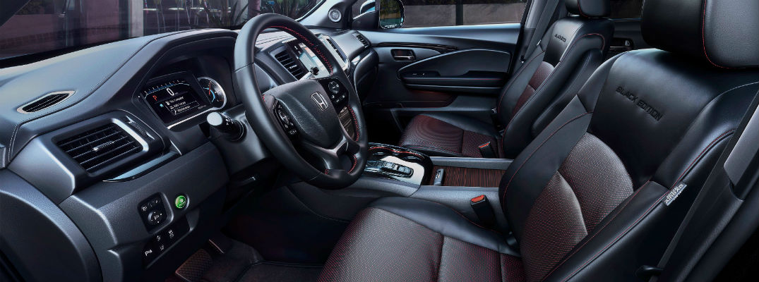 An interior photo of the driver's cockpit in the 2020 Honda Pilot Black Edition.