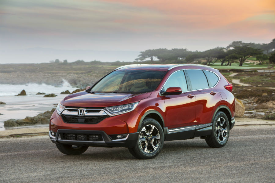 A photo of the 2019 Honda CR-V parked by the ocean.