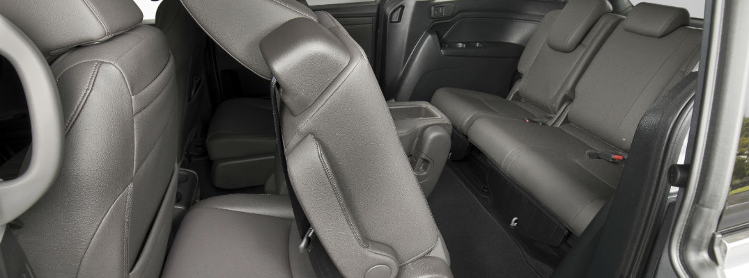 An interior photo of the second row of seats tilted forward in the 2020 Honda Odyssey.