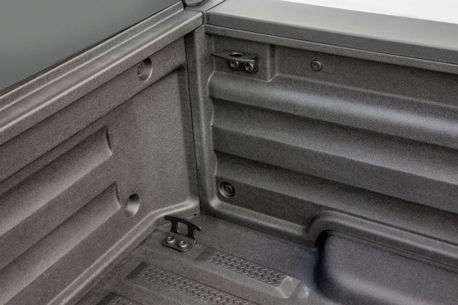 A photo of the cargo tie-down cleats in the cargo bed in the 2019 Ridgeline.