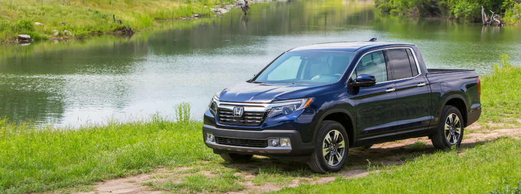 A photo of the 2020 Honda Ridgeline parked by a pond.