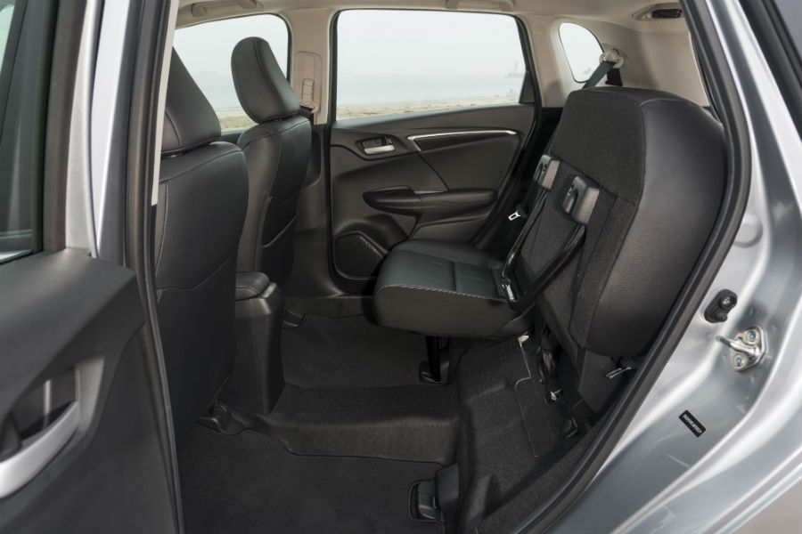 A photo of the rear seats flipped up in the back of the 2020 Fit.
