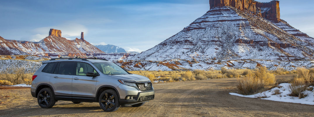 A photo of the 2020 Honda Passport parked in the desert.