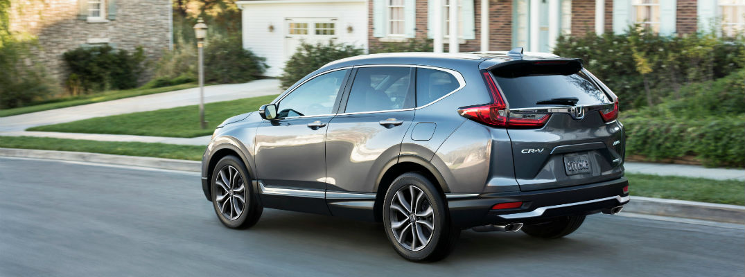 A left profile photo of the 2020 Honda CR-V parked on the street.