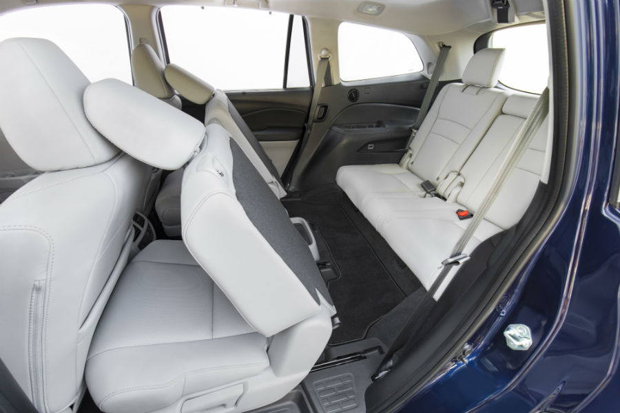 A photo of the second row of seats folded forward in the 2021 Honda Pilot.
