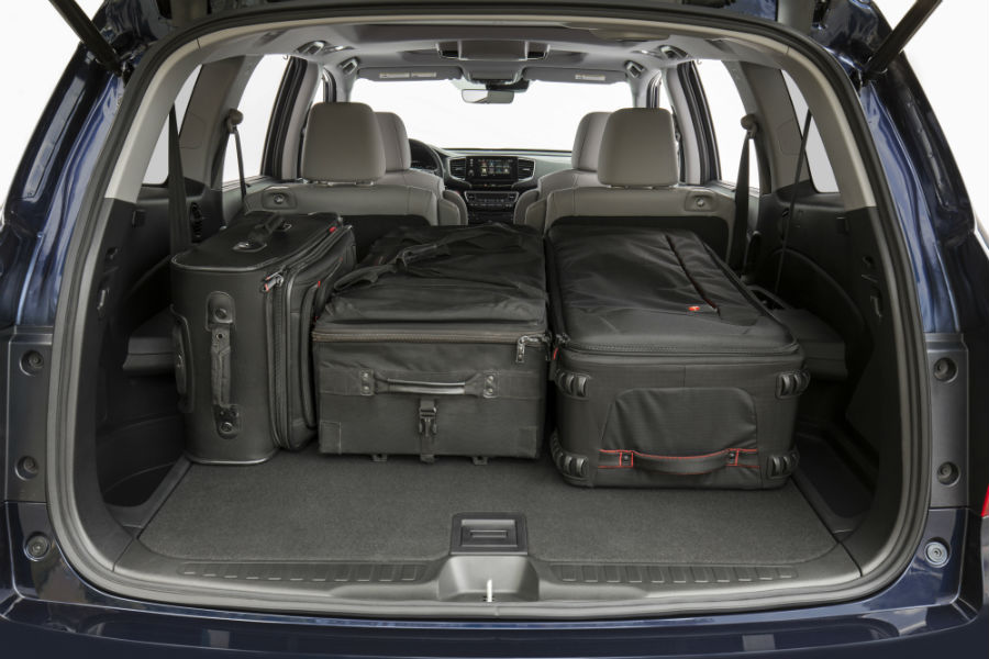 A photo of luggage stored in the back of the 2021 Honda Pilot.