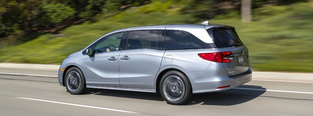 A left profile photo of the 2021 Honda Odyssey on the road.