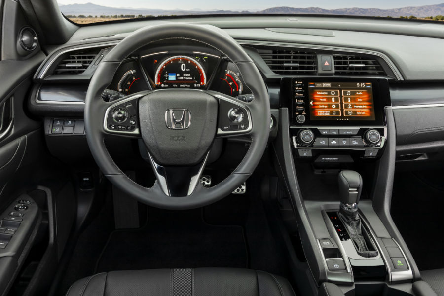 A photo of the driver's cockpit in the 2021 Honda Civic Hatchback.