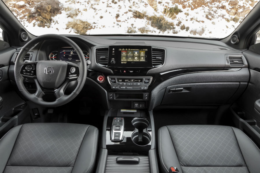 A photo of the driver's cockpit and dashboard in the 2021 Honda Passport.