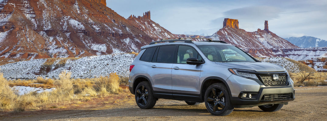 A photo of the 2021 Honda Passport parked in the desert.