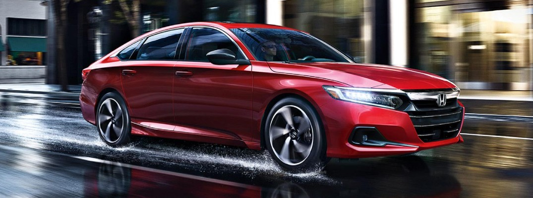 A front right quarter photo of the 2021 Honda Accord on a rain-covered road.