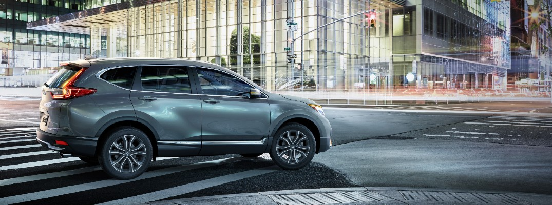 A right profile photo of the 2021 Honda CR-V going around a corner.