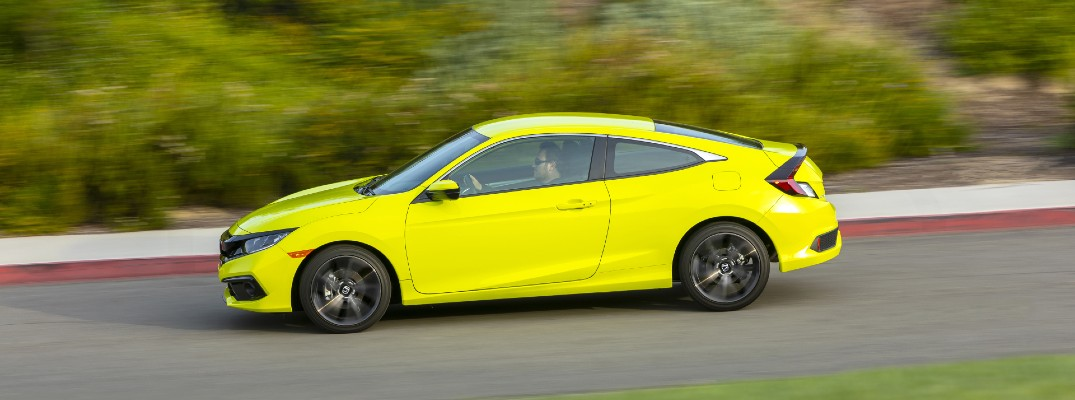 A left profile photo of the 2020 Honda Civic Coupe on the road.