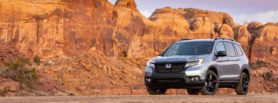 A front-left quarter photo of the 2021 Honda Passport parked in the desert.