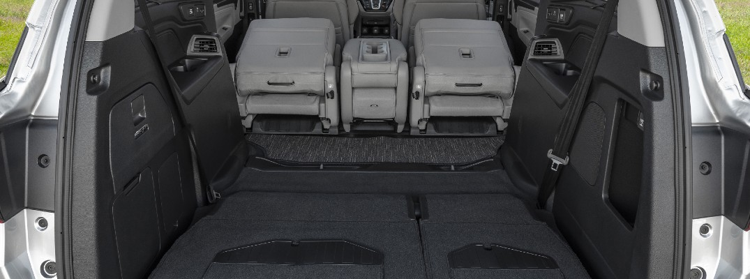 A photo of the 2021 Honda Odyssey and its massive cargo area.