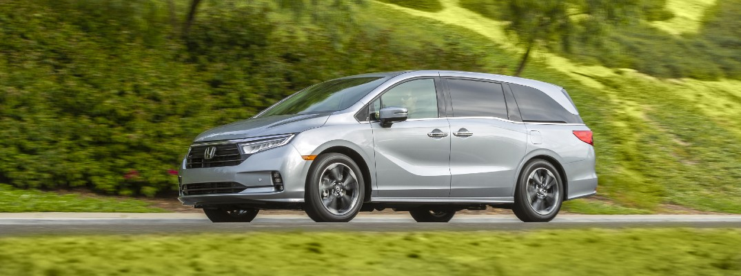 A left profile photo of the 2022 Honda Odyssey on the road.