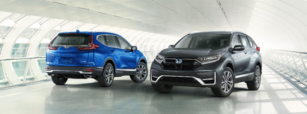 A photo of two 2021 Honda CR-V models.