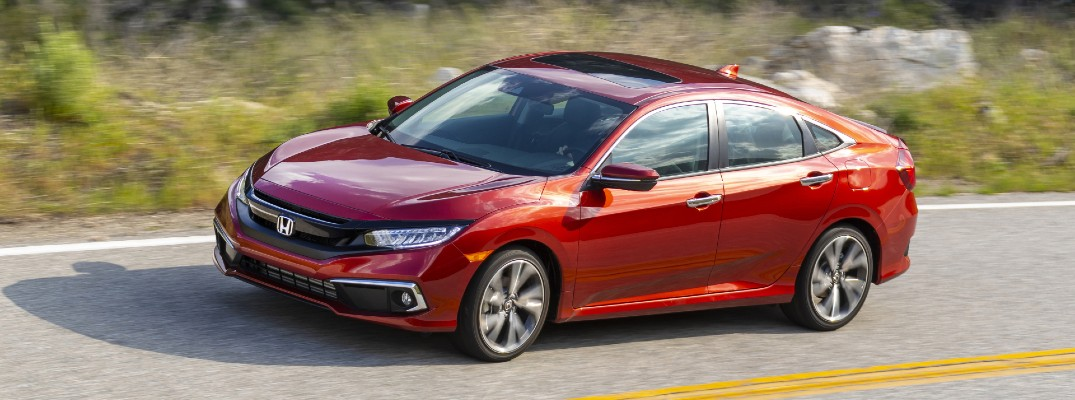 A left profile photo of the 2021 Honda Civic Touring on the road.