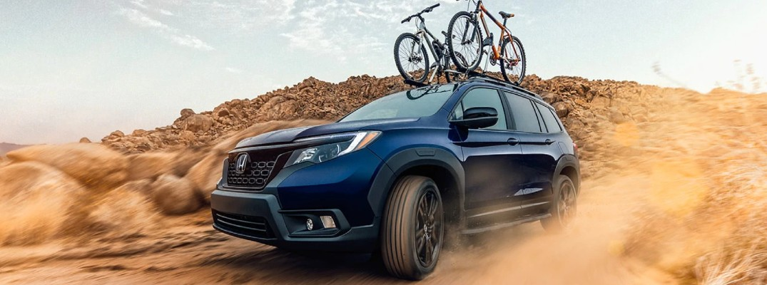A photo of the 2021 Honda Passport on a dirt road.