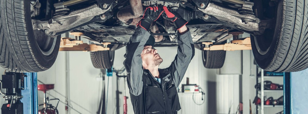 A stock photo of a person changing the oil in a vehicle.