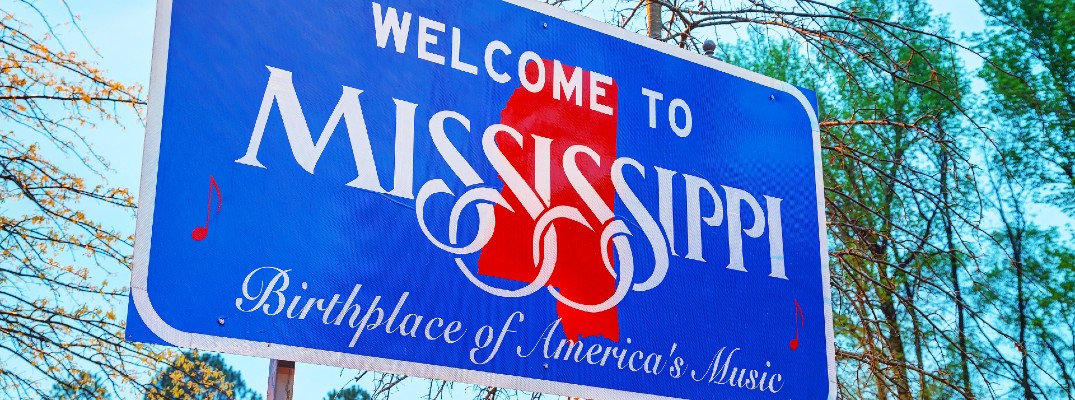 A stock photo of a 'Welcome to Mississippi' sign.