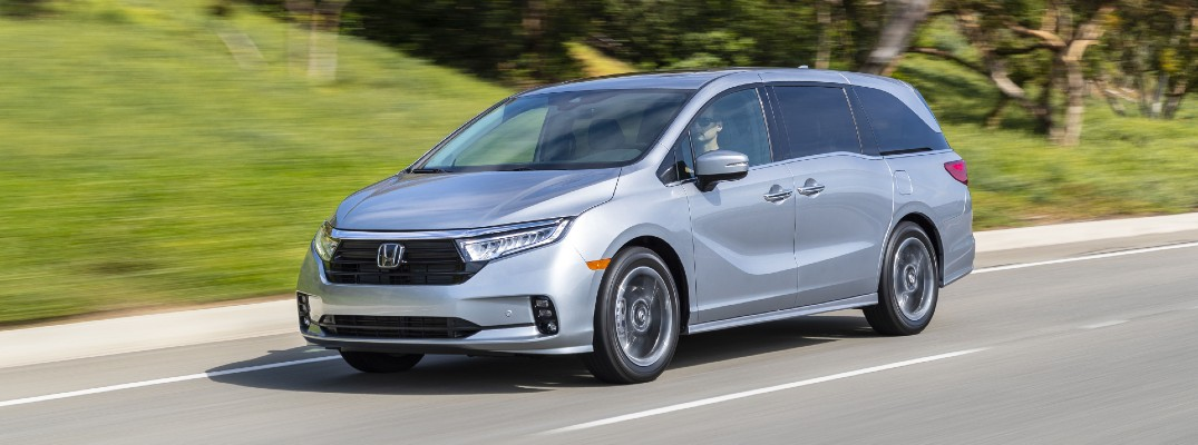 The 2022 Honda Odyssey in motion on the road.