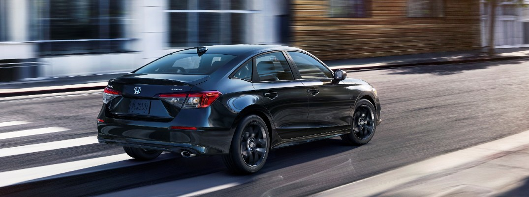 The 2022 Honda Civic in motion on the road.