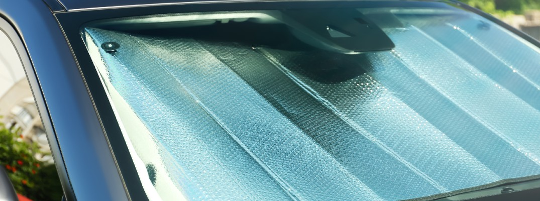 A stock photo of a vehicle using a reflective sunshade.