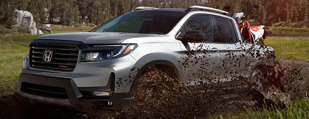 2021 Honda Ridgeline silver side view in mud