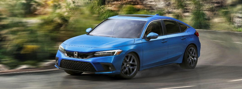 The 2022 Honda Civic Hatchback on the road.
