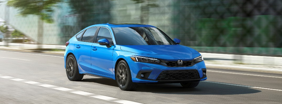 The 2022 Honda Civic Hatchback in motion on the road.