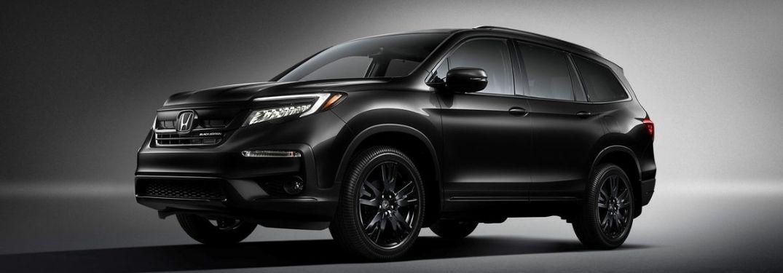Black 2022 Honda Pilot Black Edition on Dark Background