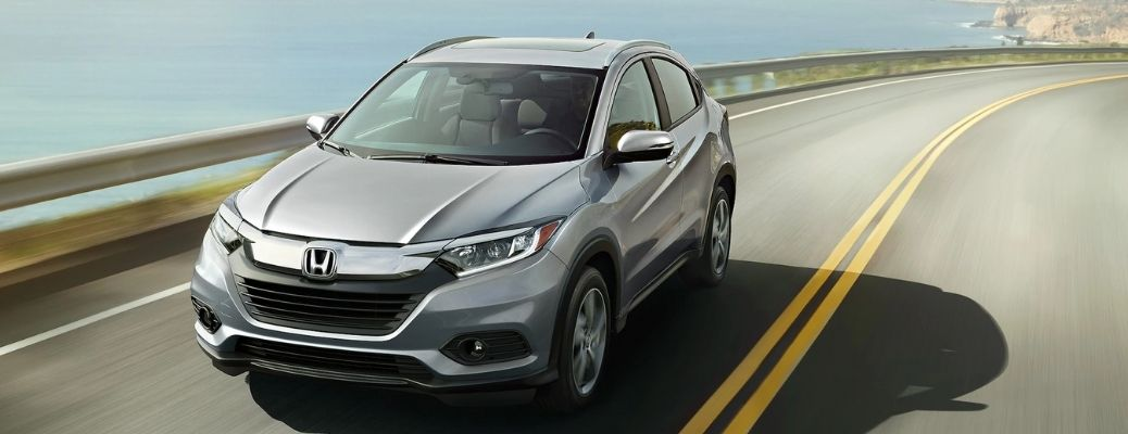 View of the 2022 Honda HR-V on road near a water body