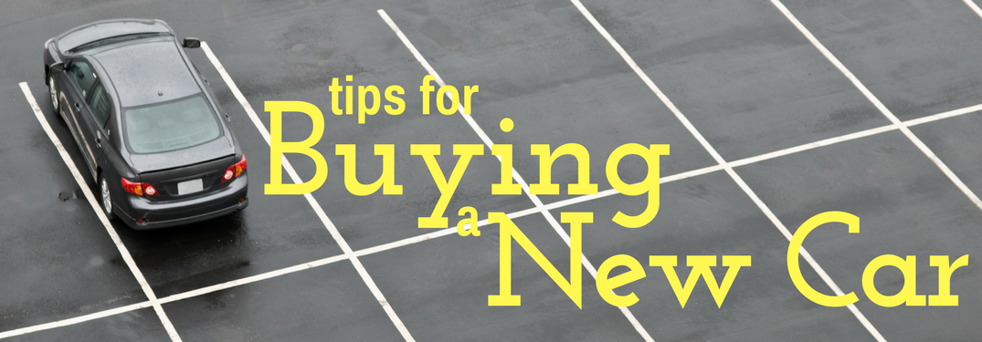 Tips for buying a new car on a parking lot background
