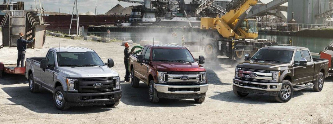 Red And Bronze  Ford F Series Super Duty Models On Construction Site