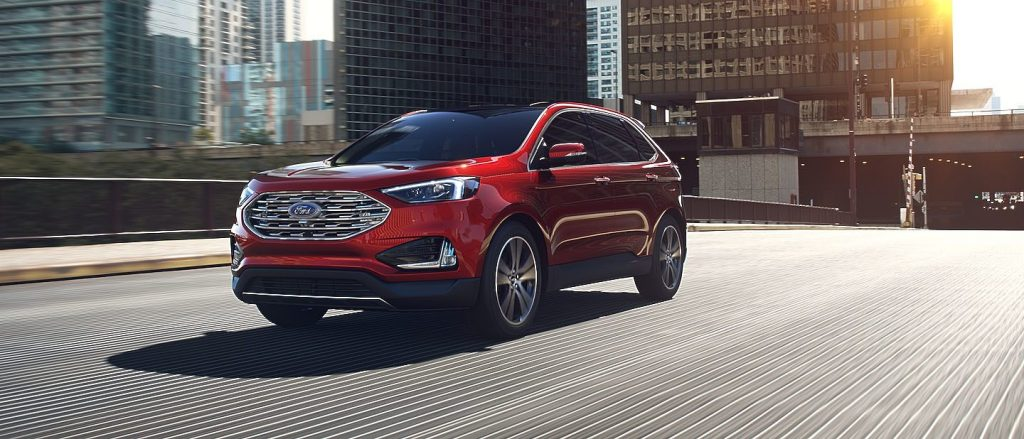 Ruby Red  Ford Edge Front Exterior On Freeway