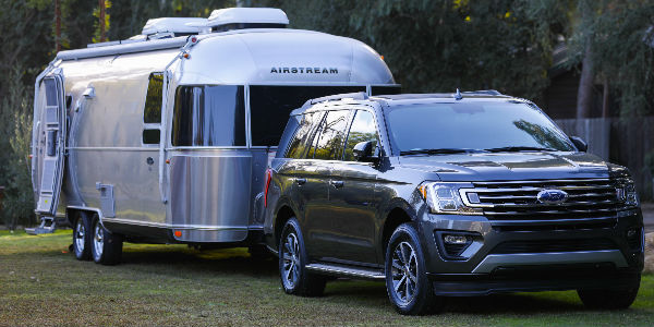 Black  Ford Expedition Towing An Airstream Trailer