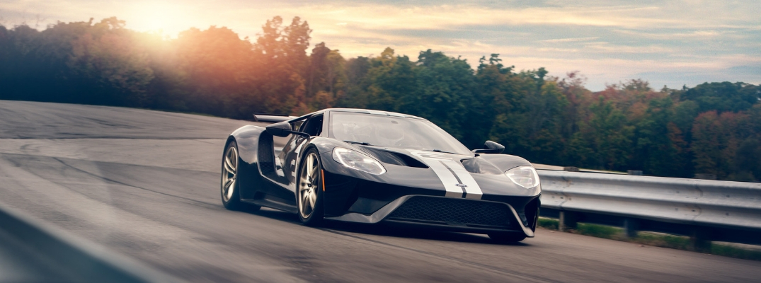 Black and White 2019 Ford GT Driving on a Track