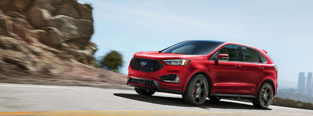 Red 2019 Ford Edge ST Driving on a Desert Highway