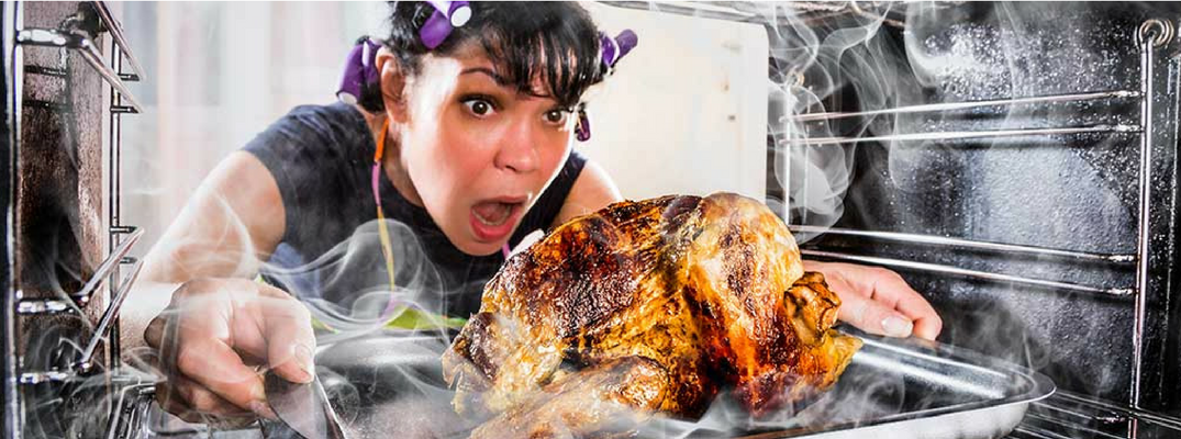 Woman Pulling a Burnt Turkey Out of the Oven