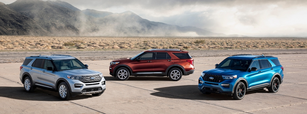 Silver, Red and Blue 2020 Ford Explorer Models on a Desert Runway