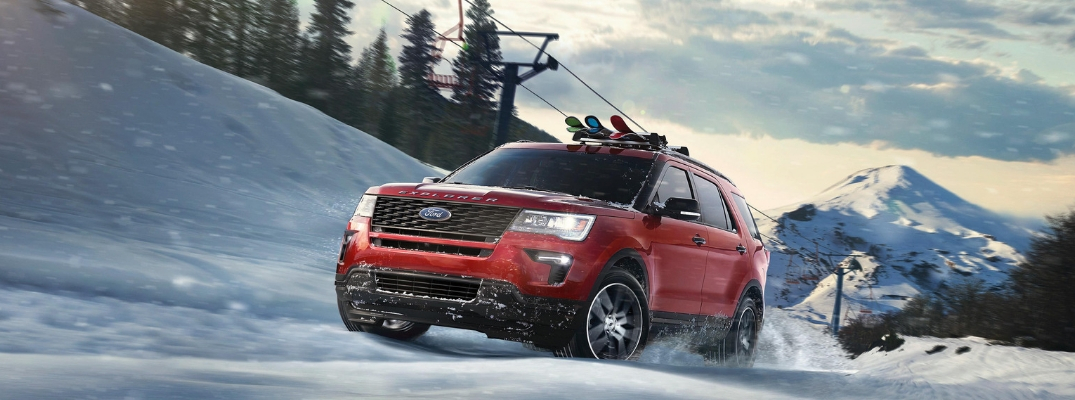 Ruby Red 2019 Ford Explorer Sport on a Ski Hill